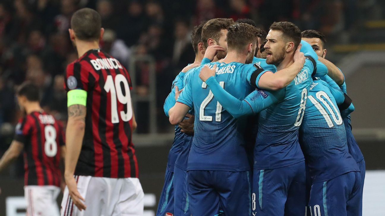 Arsenal celebrate their second goal against AC Milan.