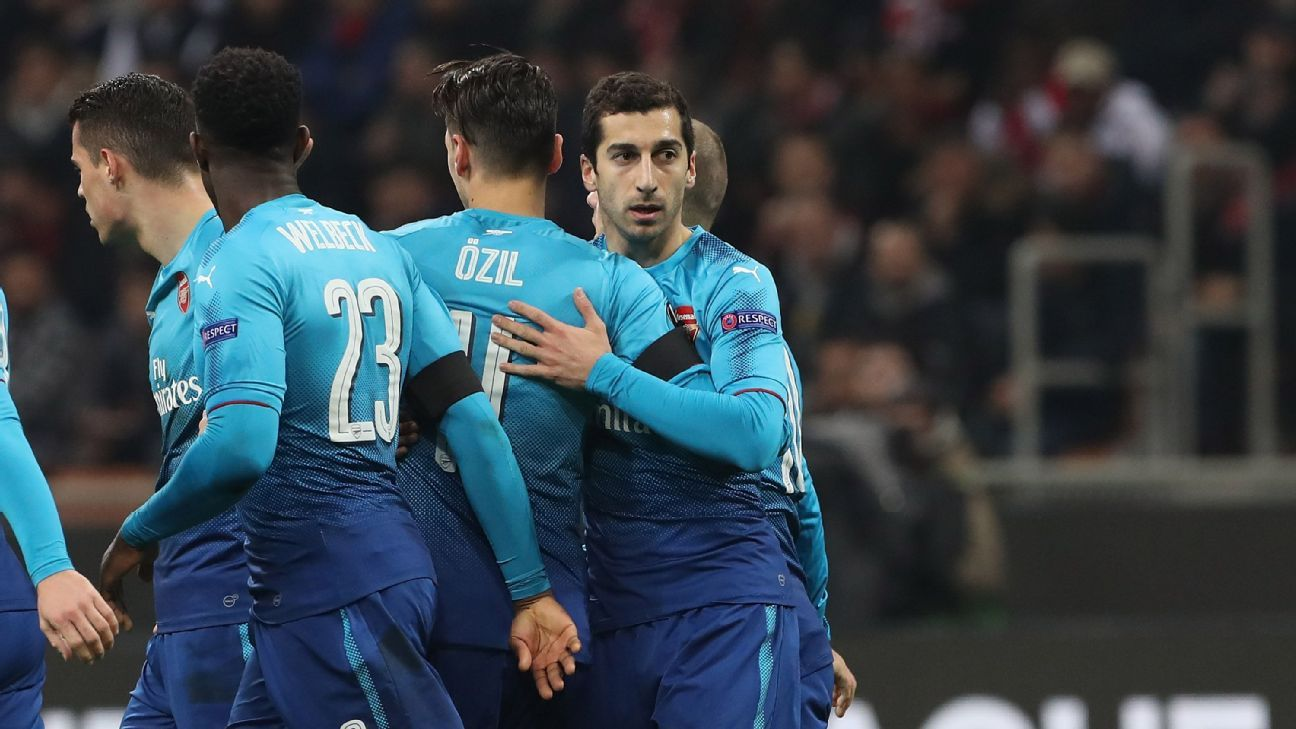 Henrikh Mkhitaryan celebrates with teammates after scoring vs. Milan.