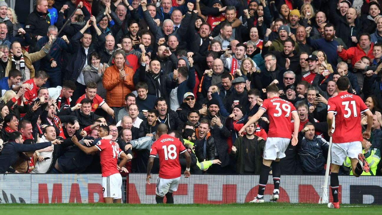 Marcus Rashford celebrates after scoring for Manchester United in their Premier League game against Liverpool.