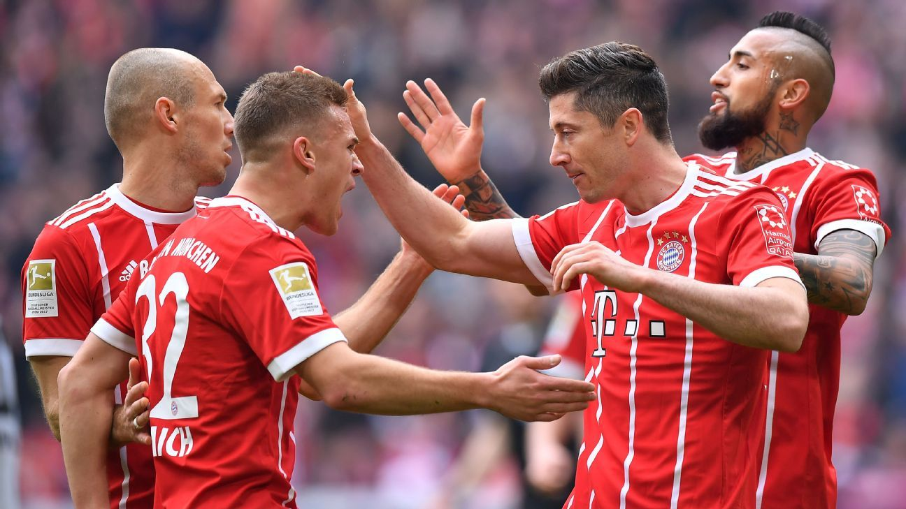 Bayern Munich players celebrate a goal during their Bundesliga game against Hamburg.