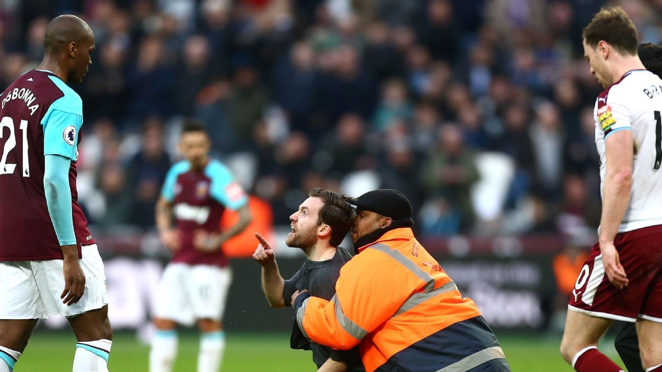 Angelo Ogbonna is confronted by a West Ham fan.