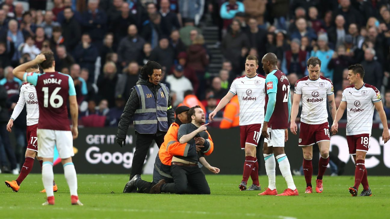 Angelo Ogbonna is confronted by a West Ham supporter.