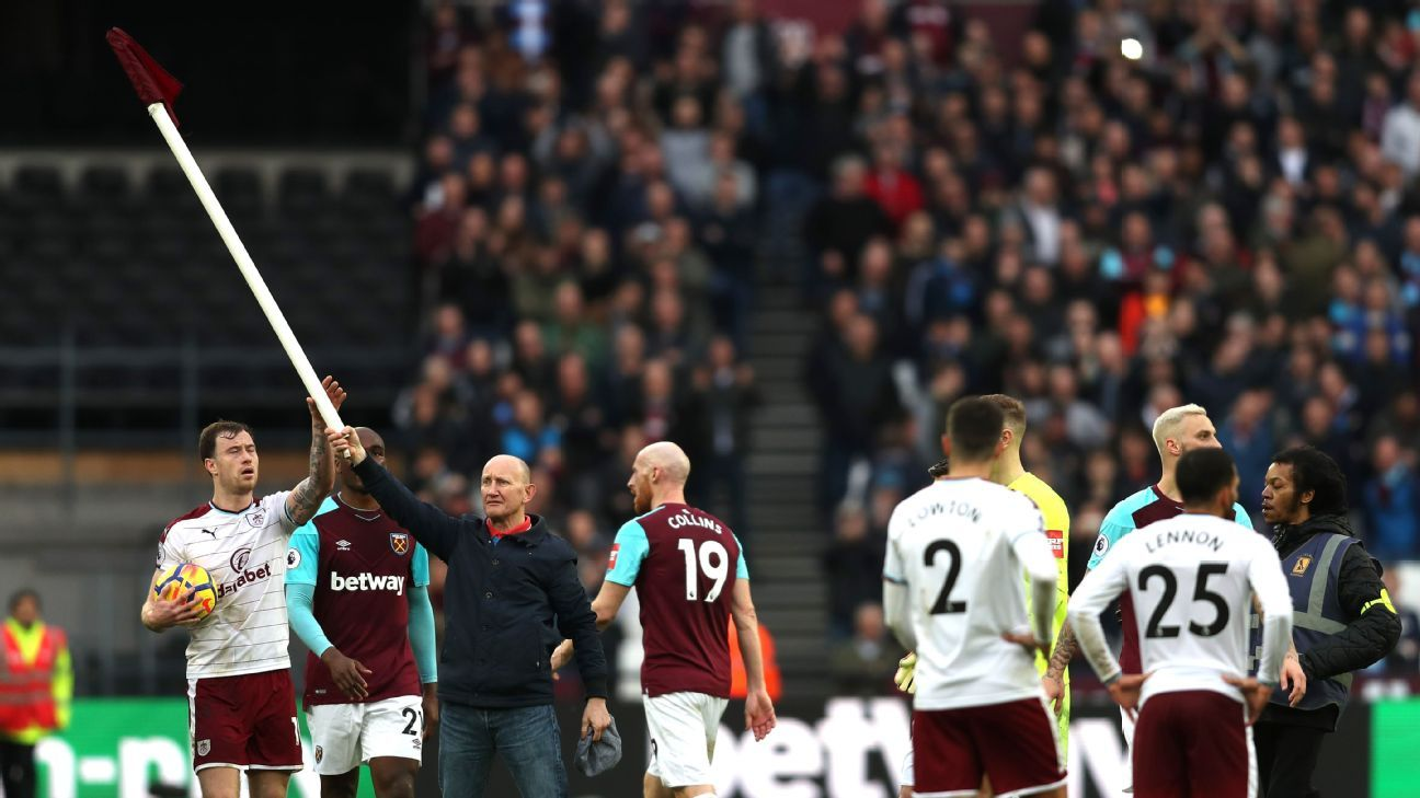 A West Ham supporter took the corner flag into the field of play during the Premier League game against Burnley.