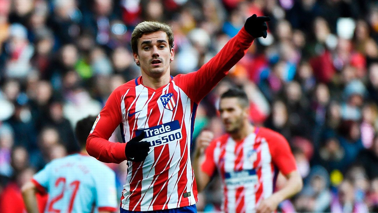 Antoine Griezmann gestures to a teammate during Atletico Madrid's win against Celta Vigo.