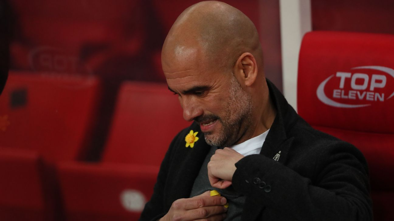 Pep Guardiola removes his yellow ribbon in support of  jailed Catalan independence leaders ahead of the match against Stoke.