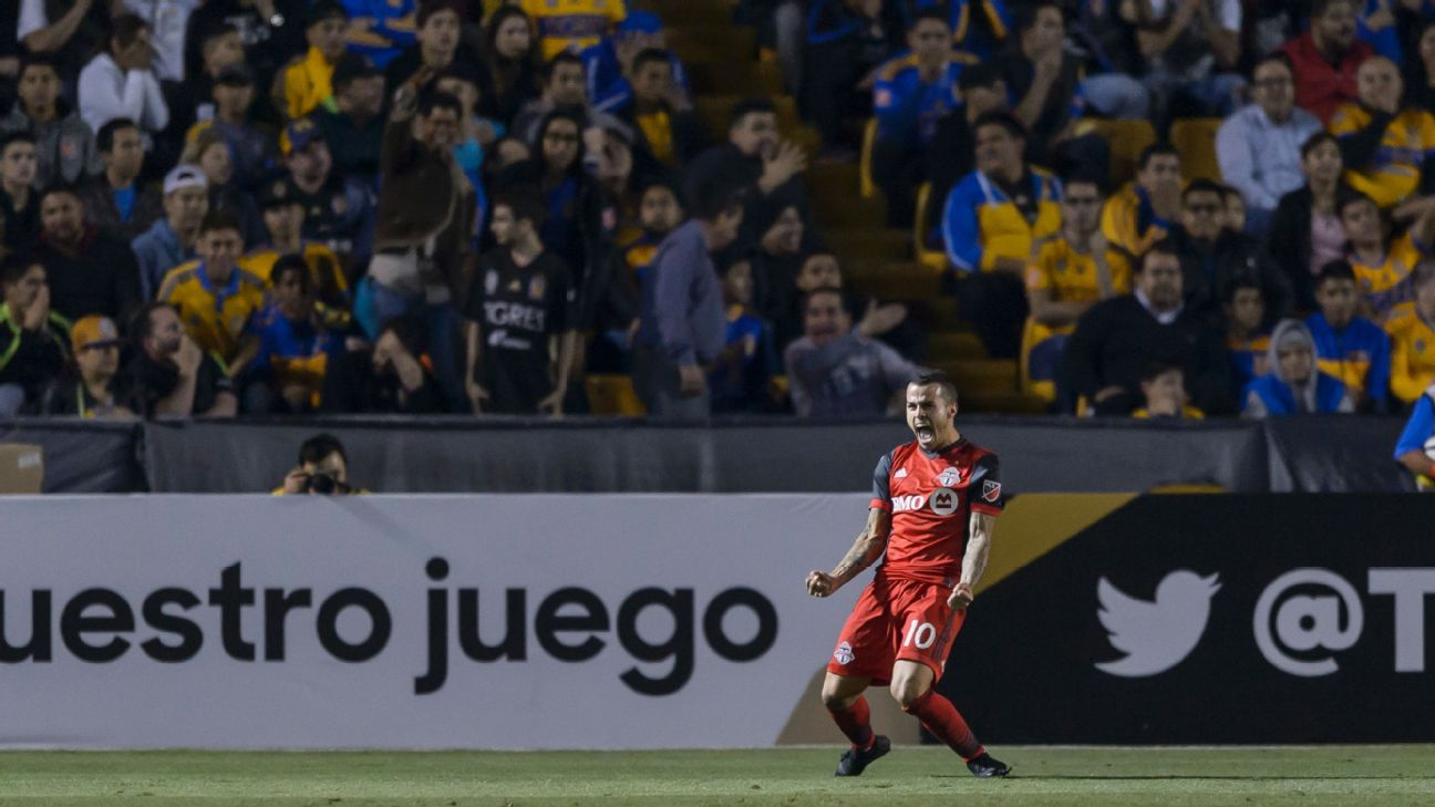 Sebastian Giovinco celebrates in front of Tigres fans after scoring a goal for Toronto in the CCL.