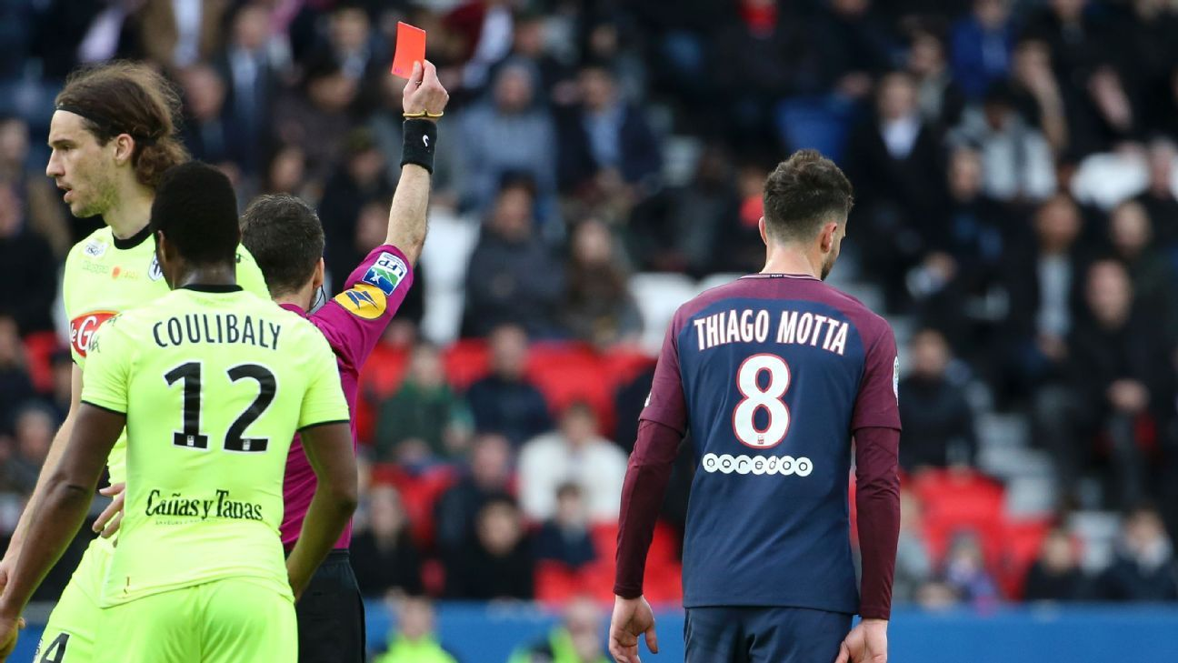 PSG's Thiago Motta leaves the pitch after being shown a straight red card for a stamp on Angers' Romain Thomas.