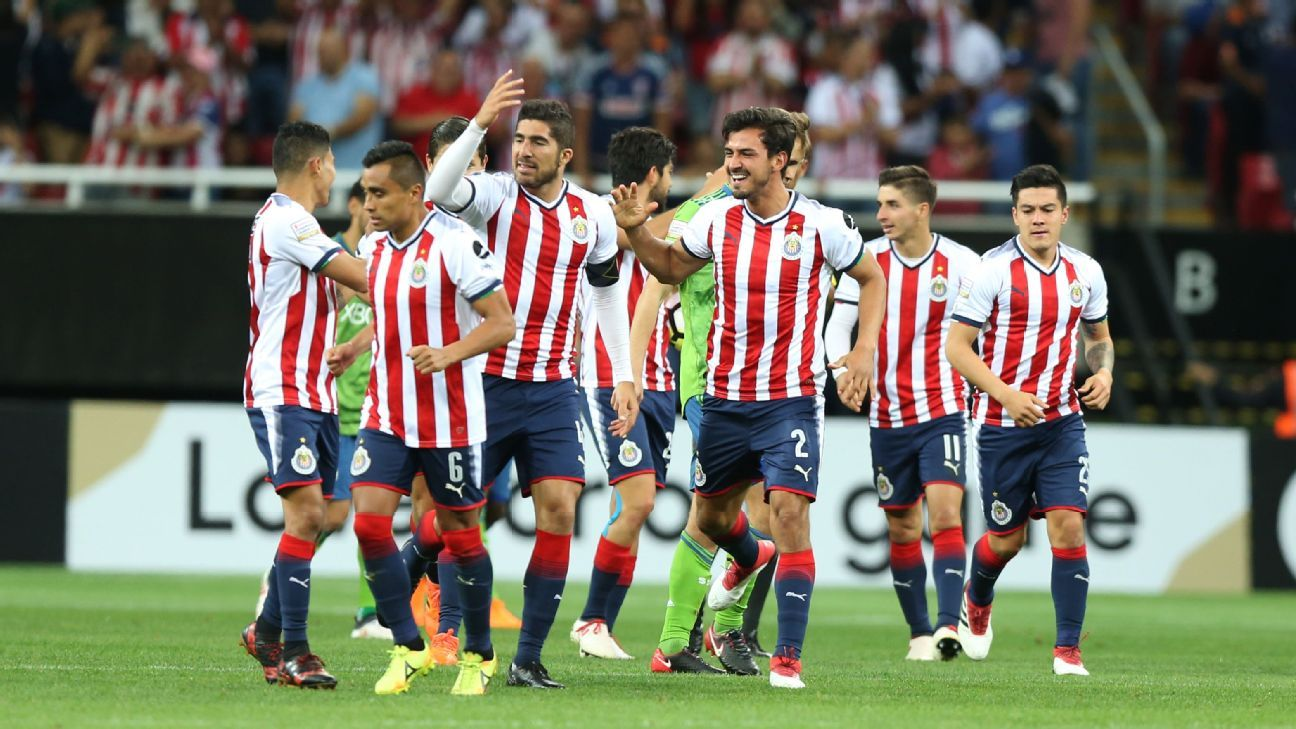 Chivas players celebrate after scoring a goal against the Seattle Sounders in the CONCACAF Champions League.