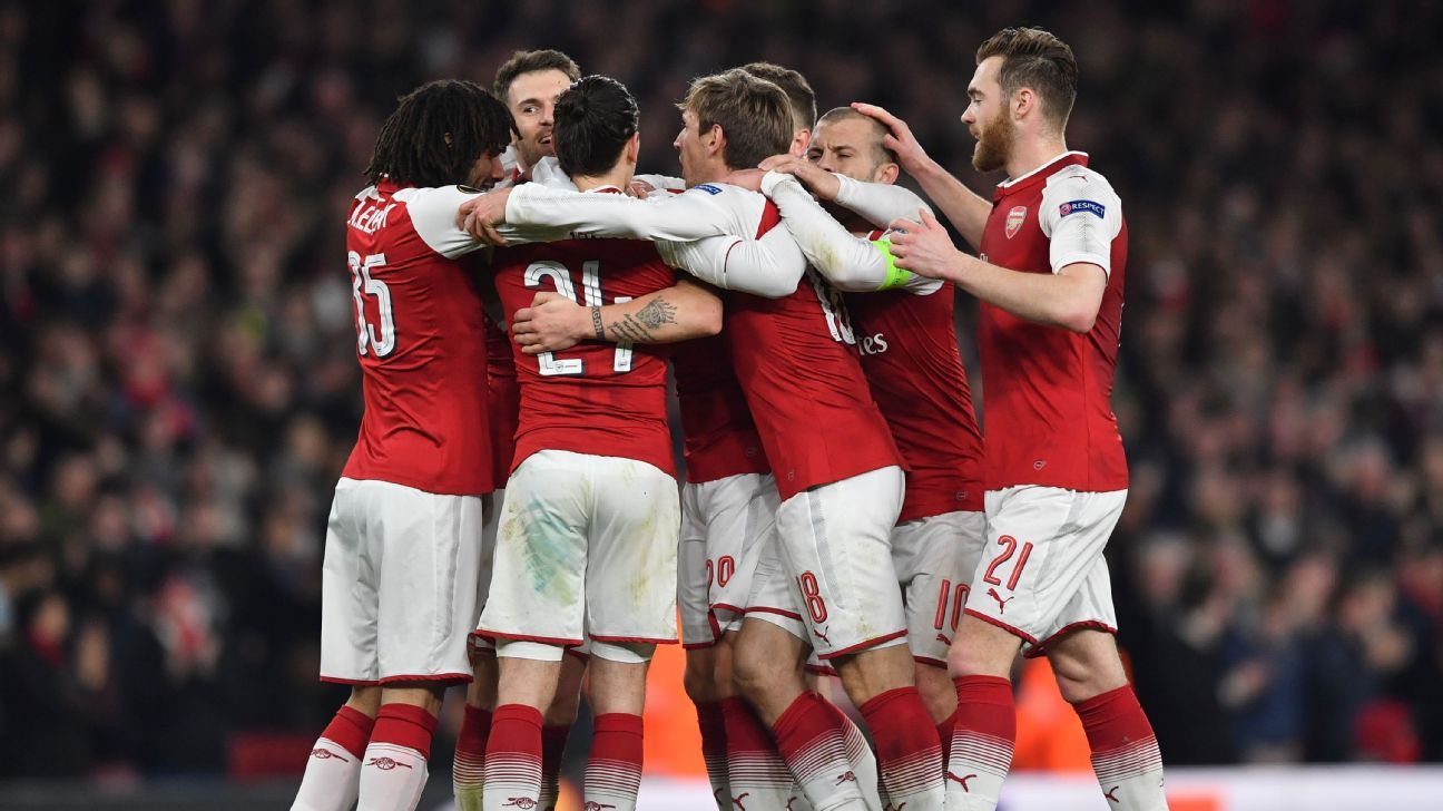Arsenal celebrate vs. AC Milan.