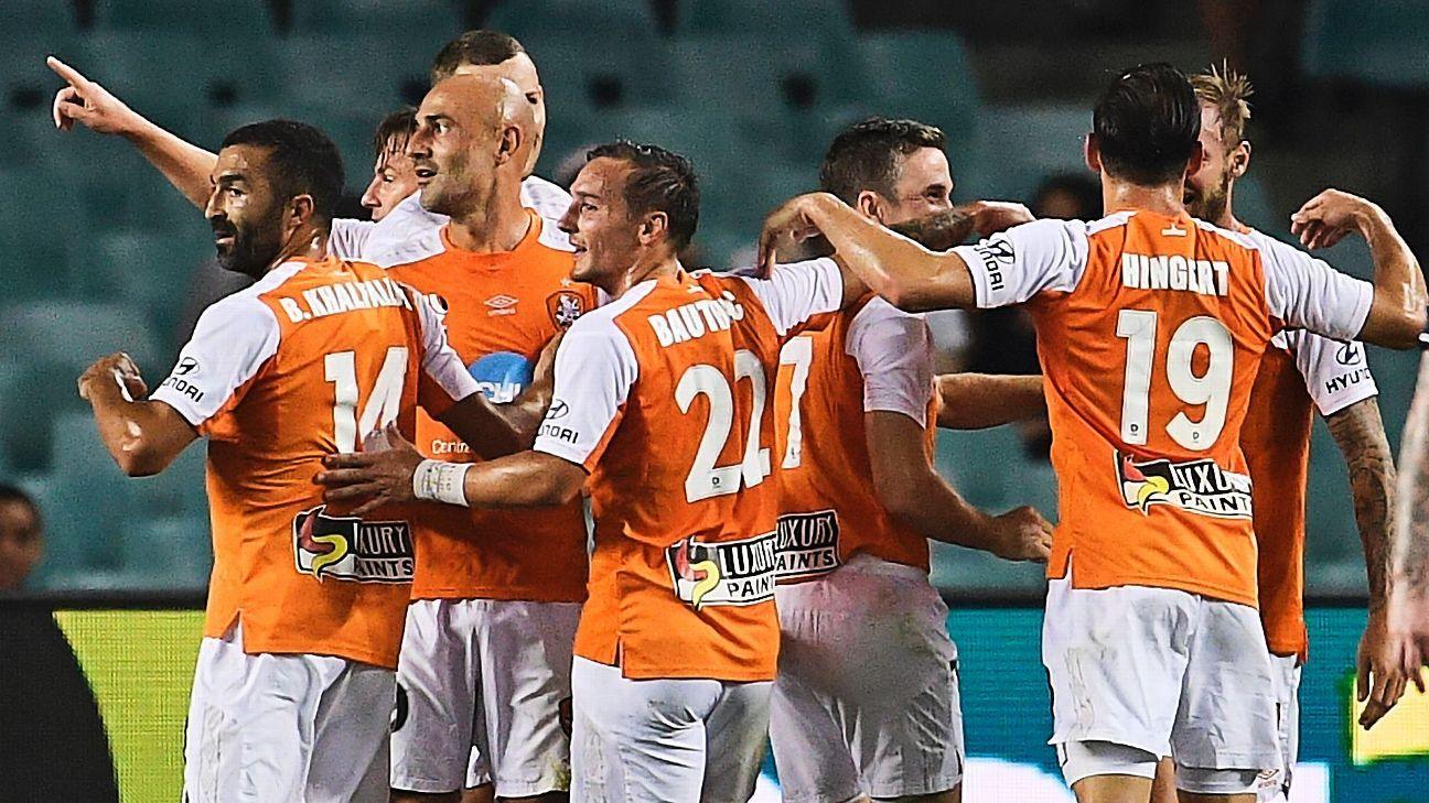 Brisbane Roar celebrate after Jacob Pepper doubled their lead.