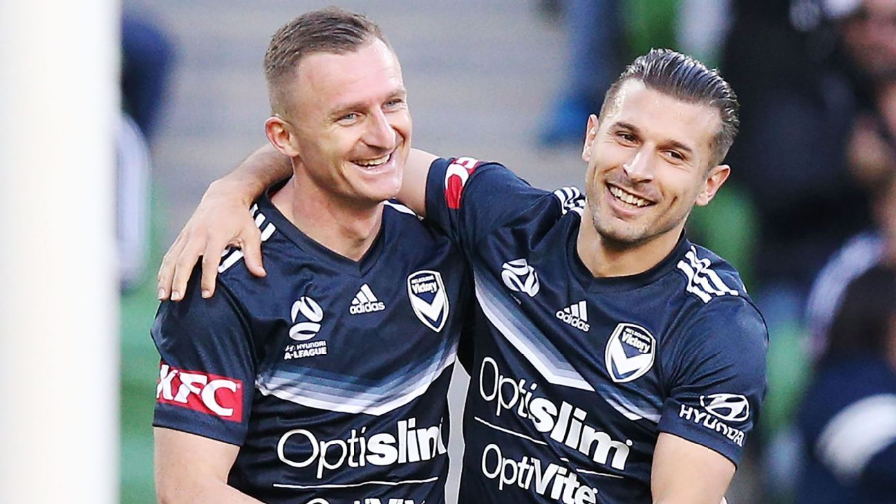 Besart Berisha celebrates a goal with Kosta Barbarouses.