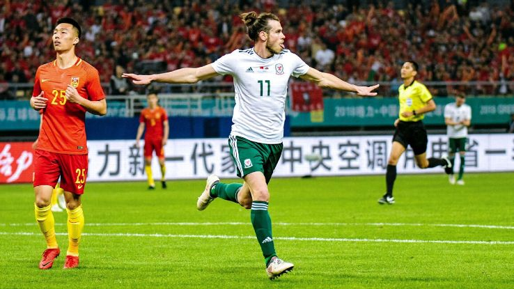 Gareth Bale celebrates after scoring his second in China.