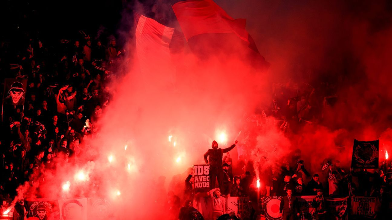 PSG fans light flares during the Champions League round of 16 second leg match against Real Madrid.