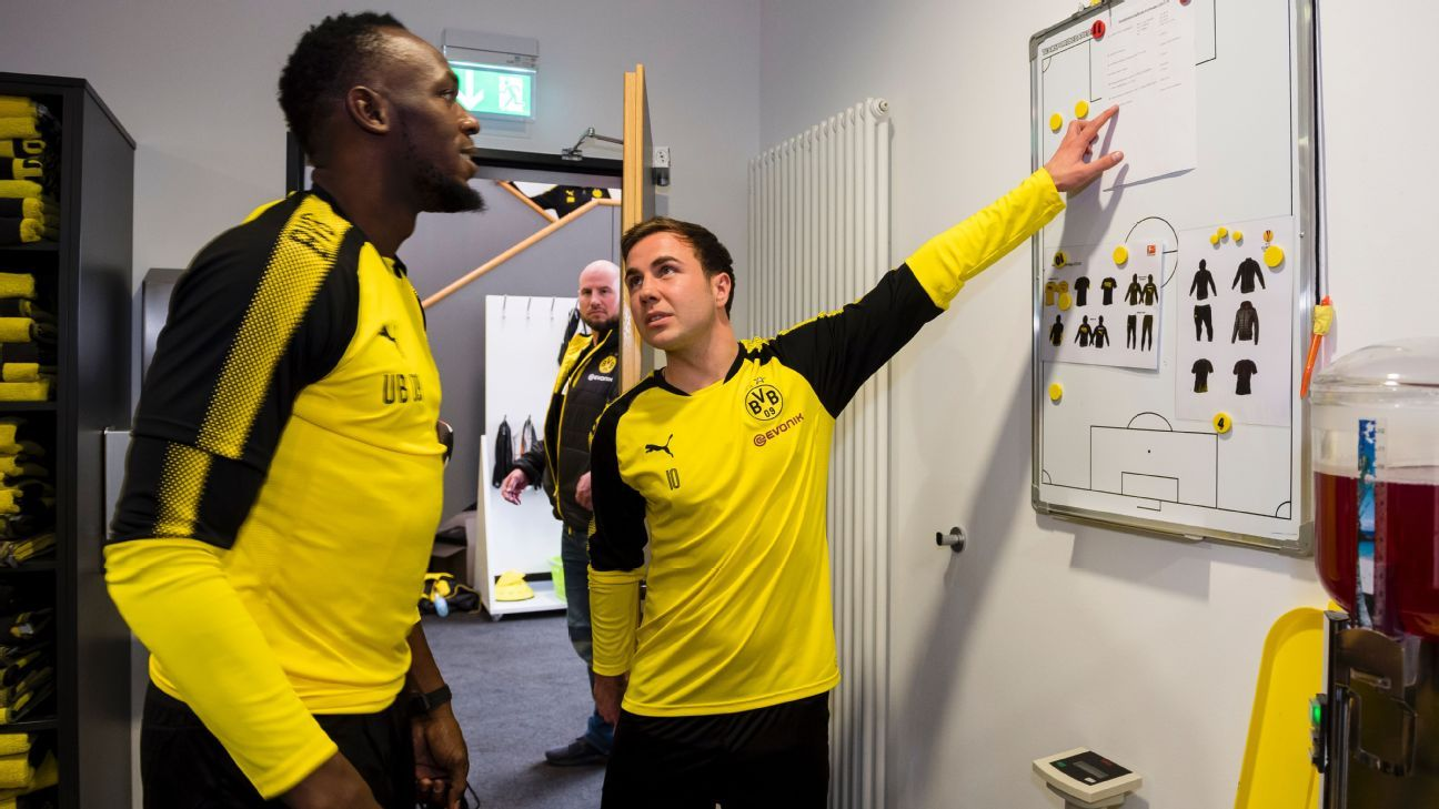 Usain Bolt runs through Dortmund team tactics with Mario Gotze.