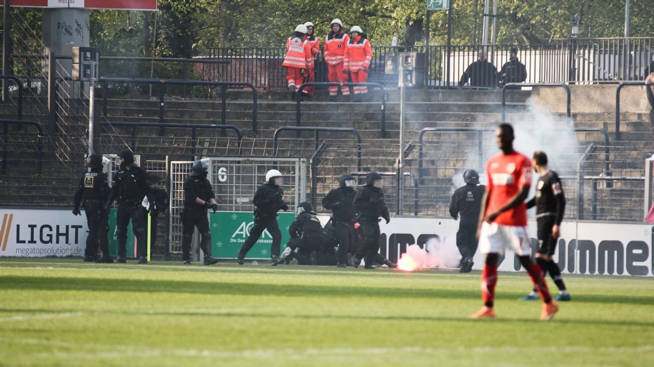 A flare is thrown on to the pitch during the match between Babelsberg and Cottbus