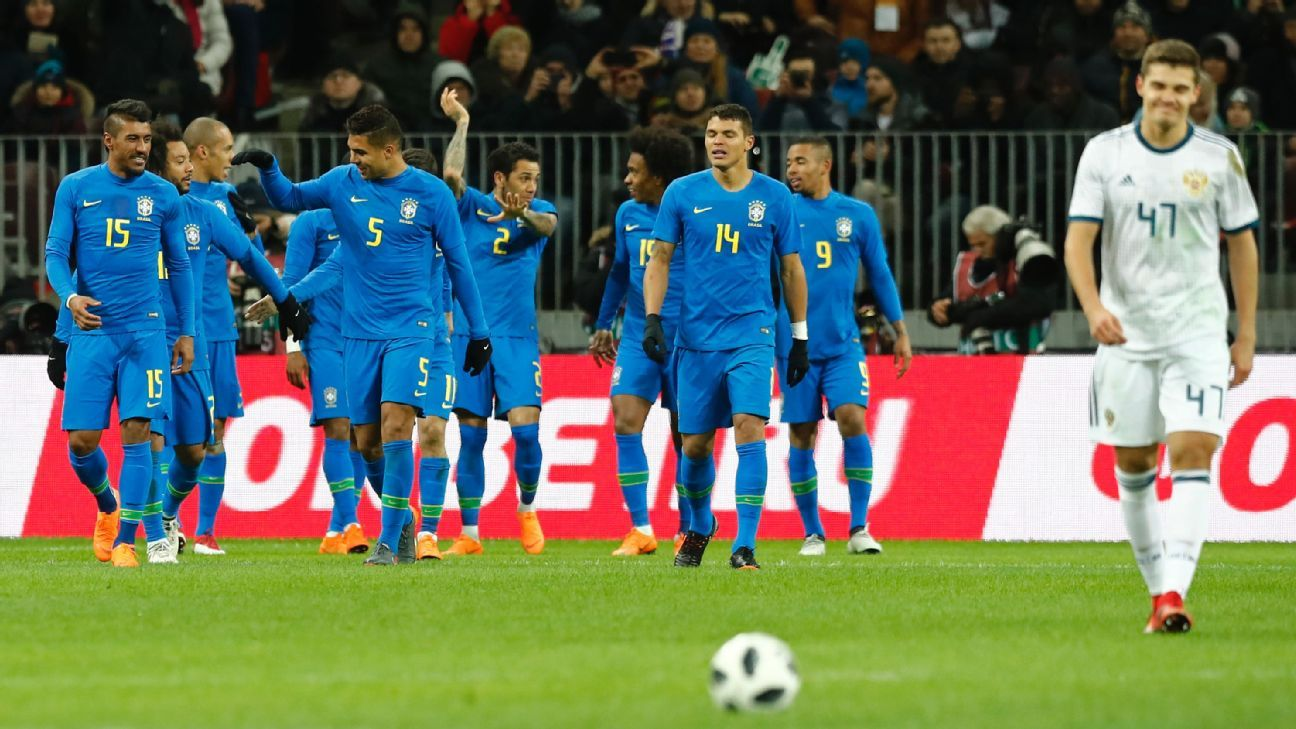 Brazil players celebrate after taking the lead against Russia.