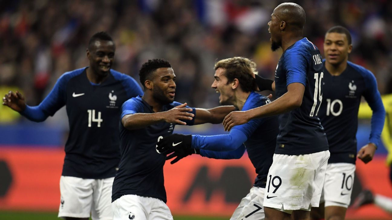Thomas Lemar celebrates with Antoine Griezmann after scoring for France during an international friendly against Colombia.