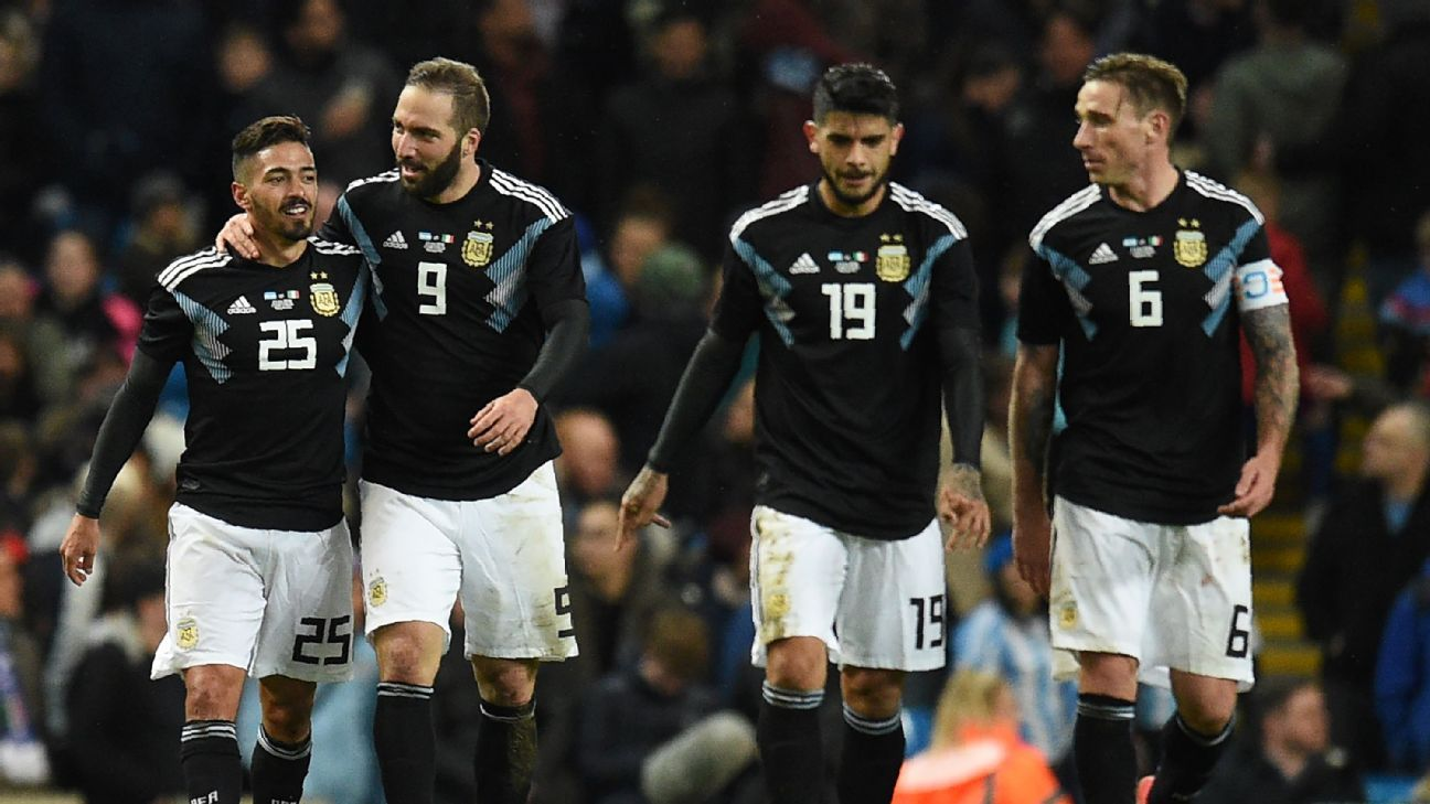Argentina celebrate Manuel Lanzini's late goal which made it 2-0.