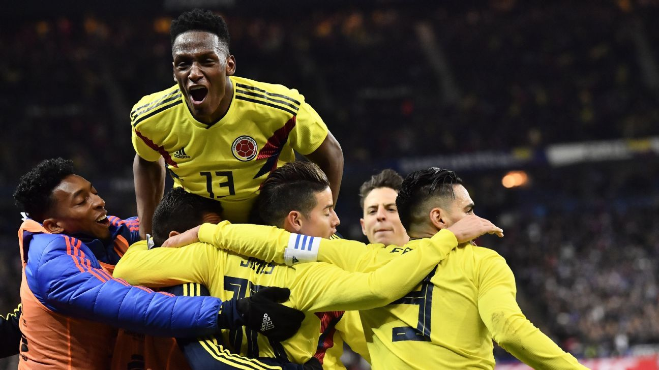 Colombia players celebrate Radamel Falcao's goal against France.