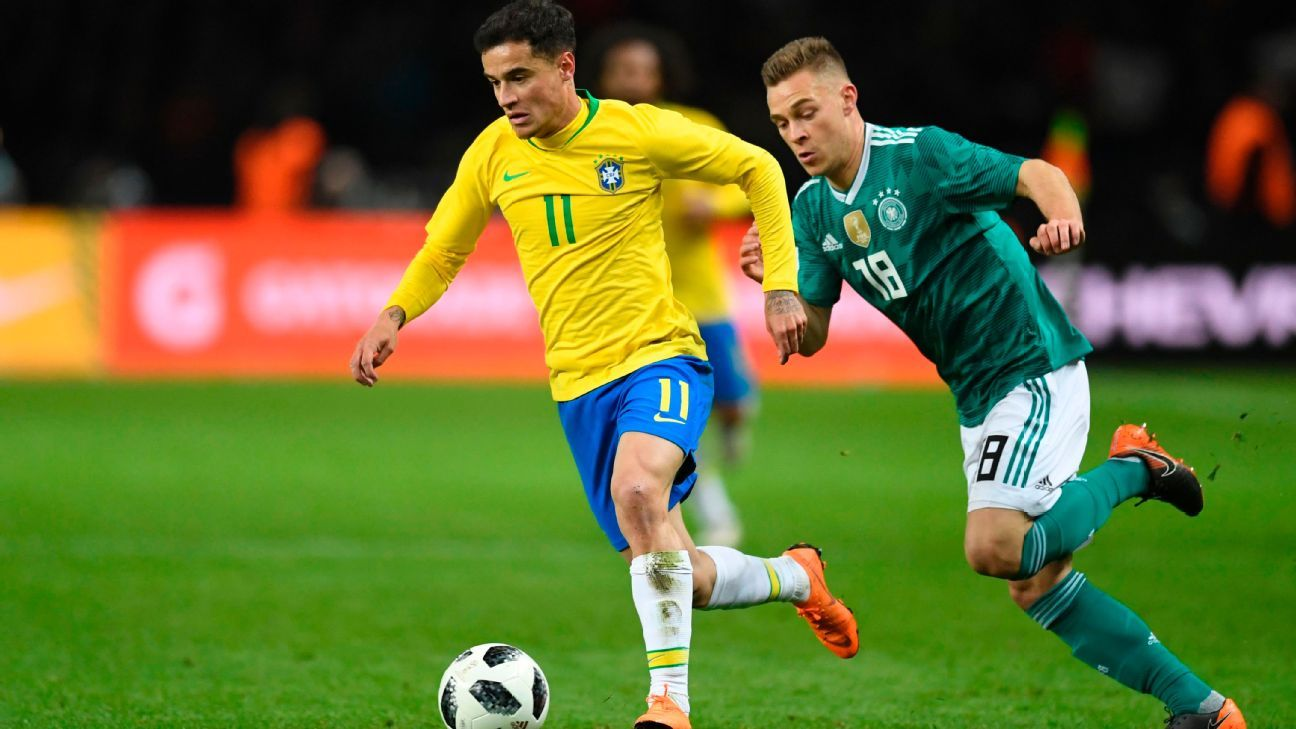 Philippe Coutinho dribbles for Brazil against Italy.
