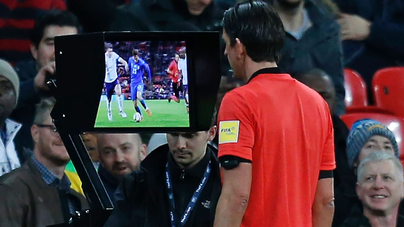 German referee Deniz Aytekin studies the VAR screen during an England friendly.
