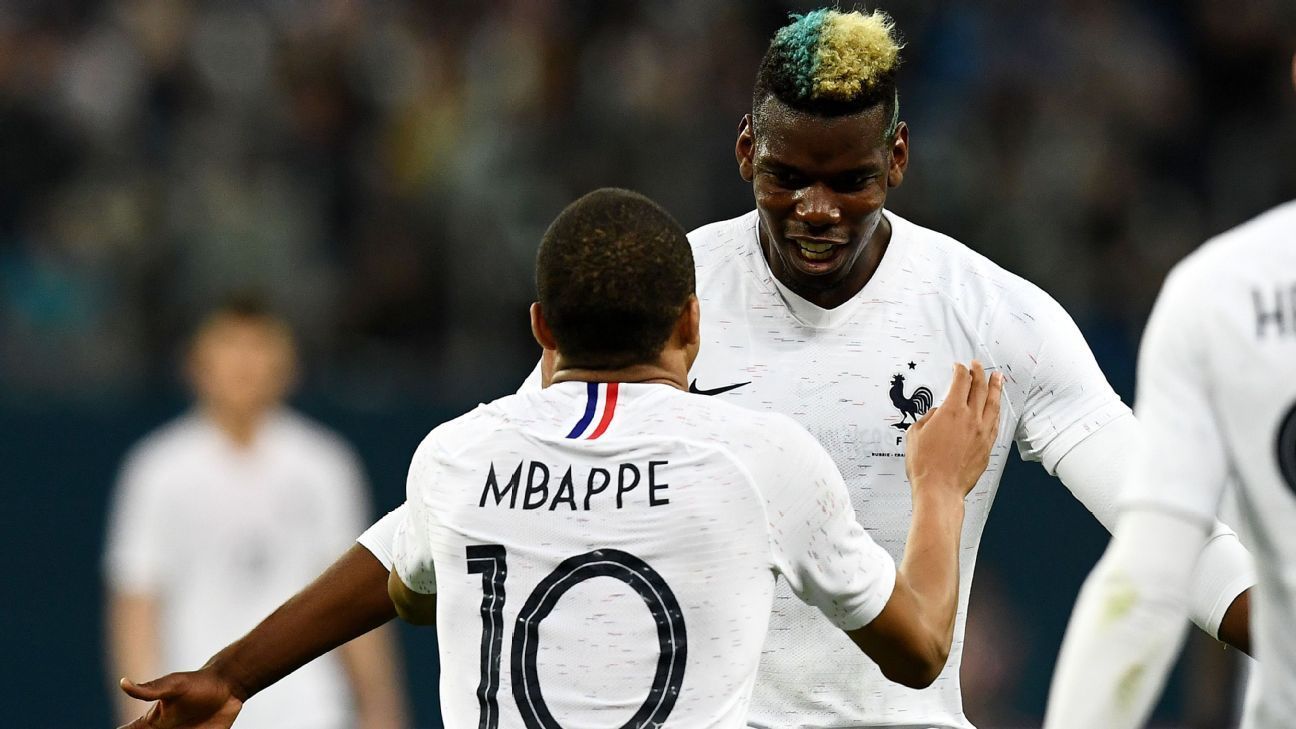 Paul Pogba and Kylian Mbappe (No. 10) celebrate after a France goal against Russia.