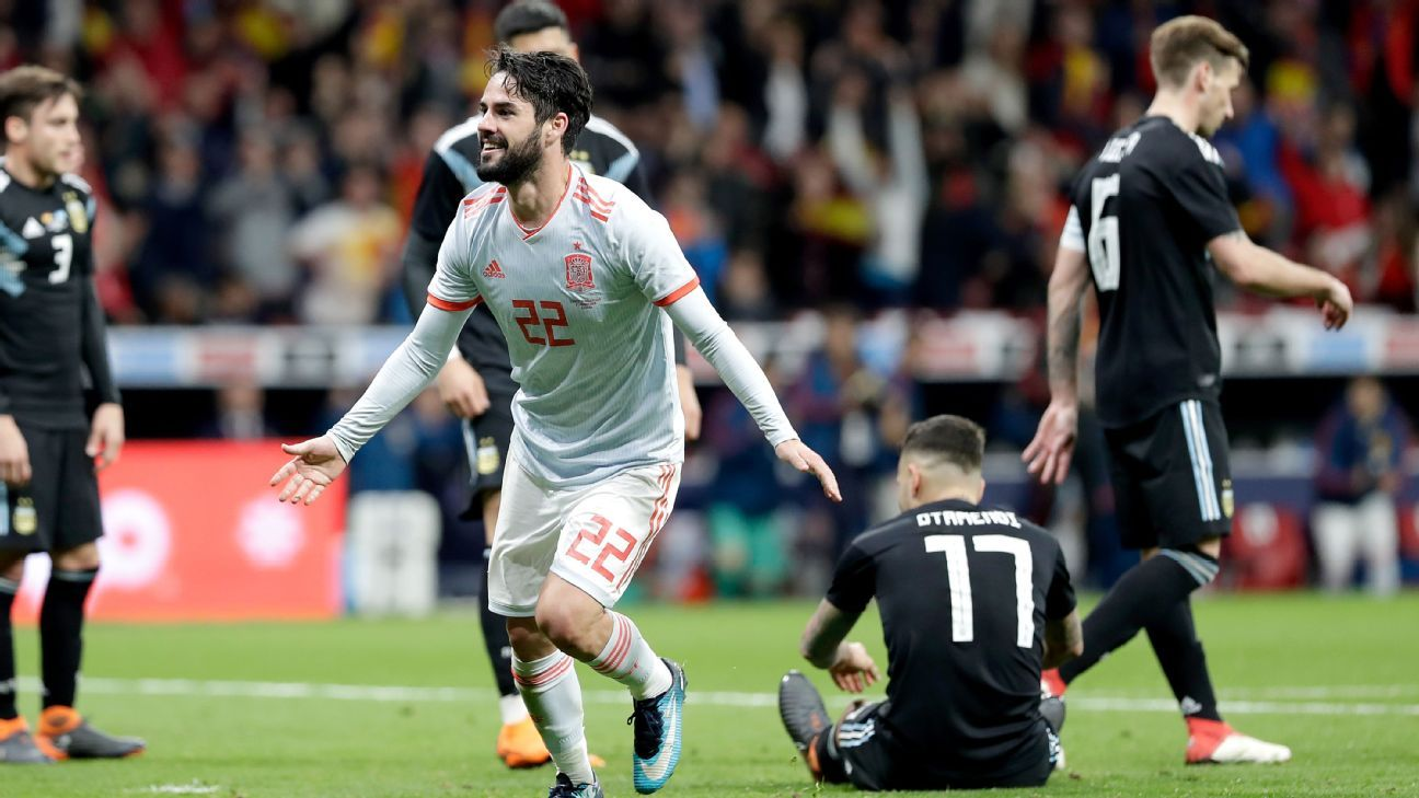 Isco celebrates after scoring a goal against Argentina in a 6-1 friendly win for Spain.