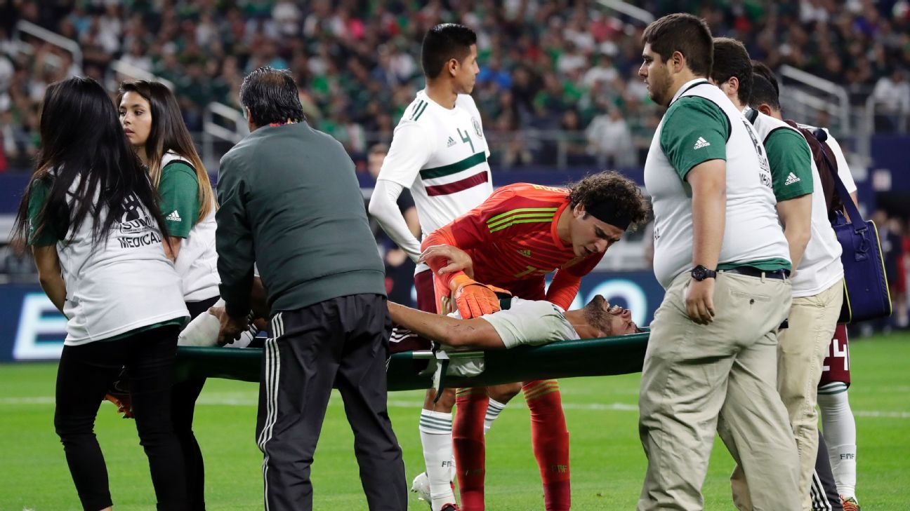 Nestor Araujo is stretchered off with an injury in the first half of Mexico's friendly with Croatia.