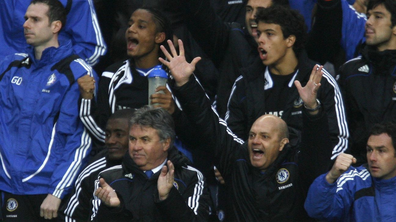Ray Wilkins, arms raised, is pictured here during one of his stints as an assistant with Chelsea.