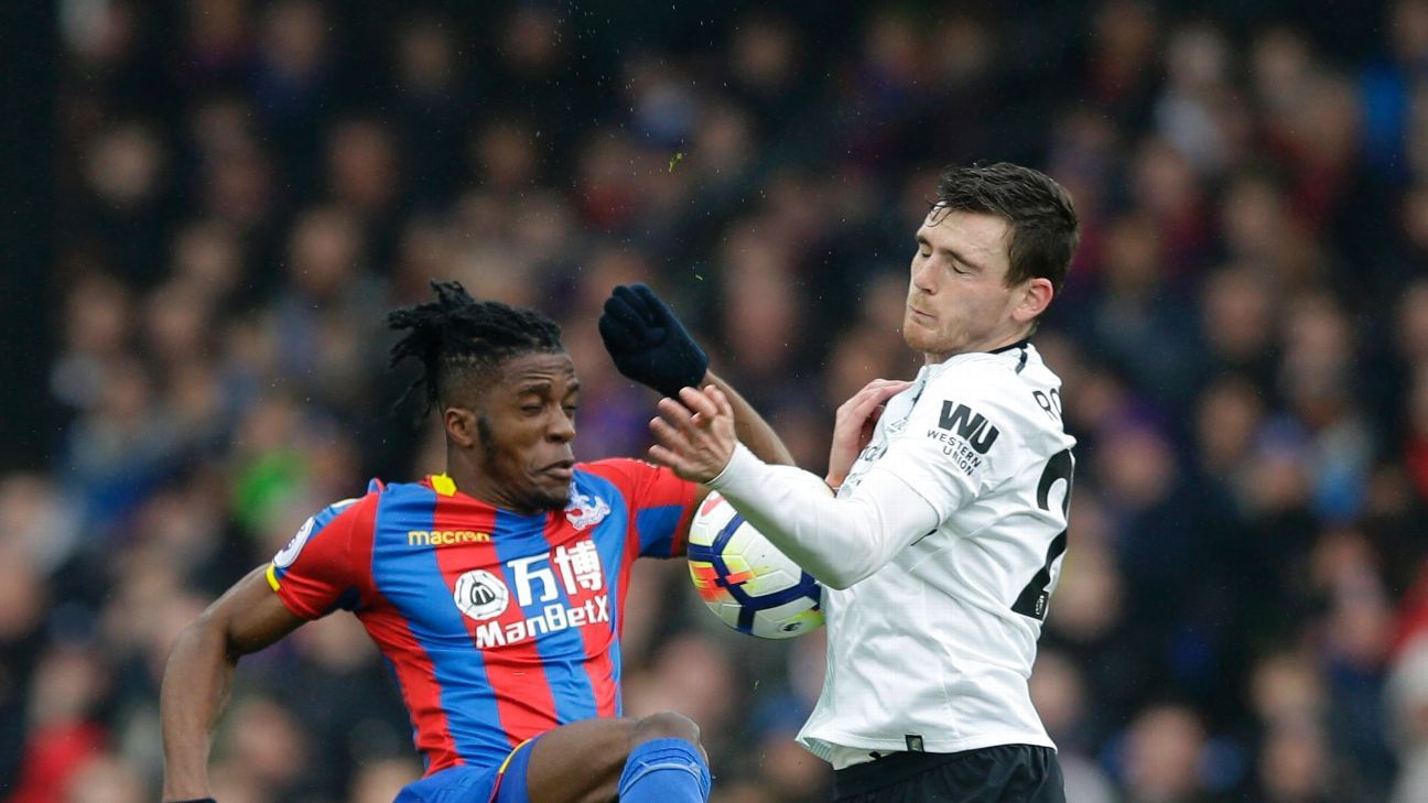 Andrew Robertson challenges Wilfried Zaha for a 50-50 ball.