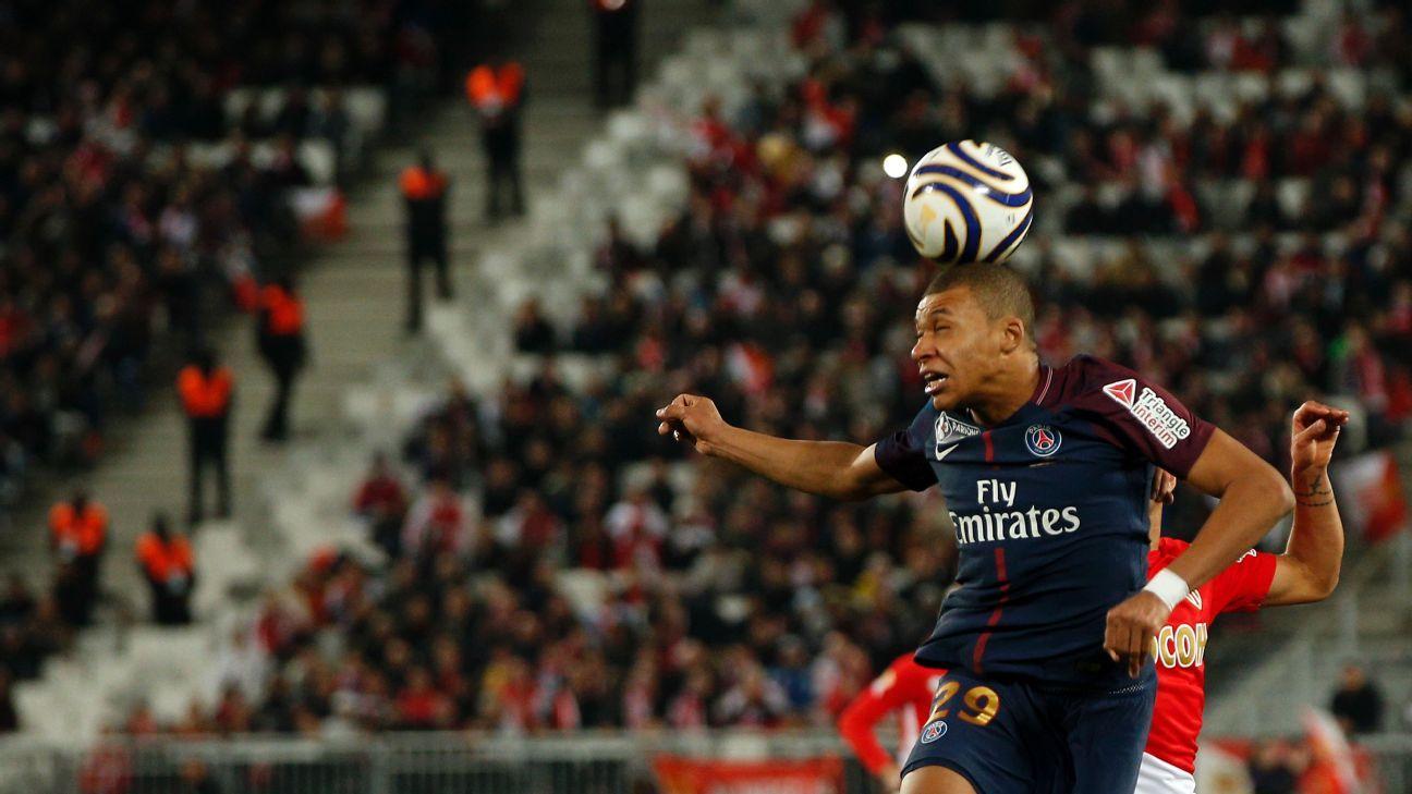 PSG's Kylian Mbappe heads the ball during his team's Coupe de la Ligue match against Monaco.