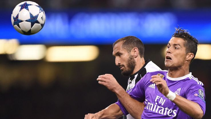 Juve's Giorgio Chiellini, left, battles for the ball with Real Madrid's Cristiano Ronaldo in the 2017 Champions League final.