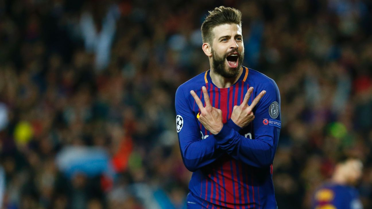 Gerard Pique celebrates scoring Barcelona's third against Roma.