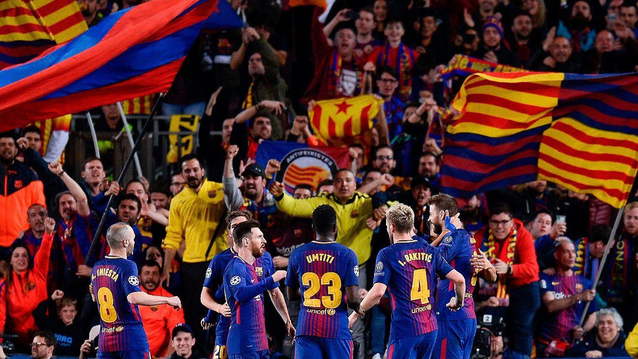 Barcelona celebrate their third goal against Roma on Wednesday.