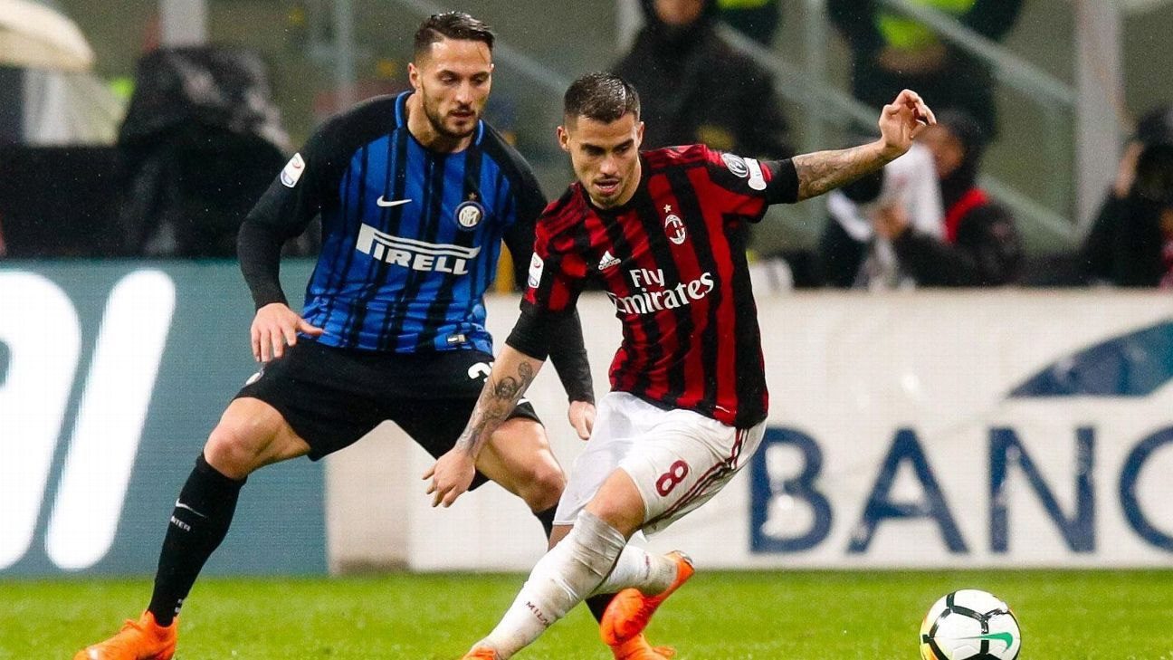 Suso, right, and Danil D'Ambrosio fight for the ball during the Milan derby.