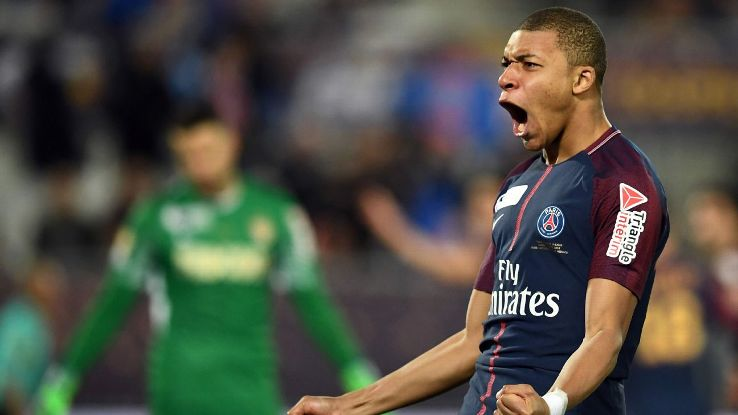Kylian Mbappe celebrates during PSG's Coupe de la Ligue final win over Monaco.