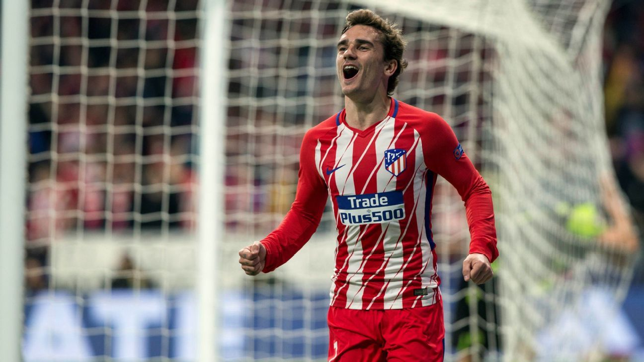 Antoine Griezmann scores during Atletico Madrid's 2-0 win over Sporting.