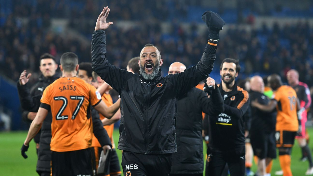 Wolves' boss Nuno Espirito Santo celebrates after his team's Championship win against Cardiff.