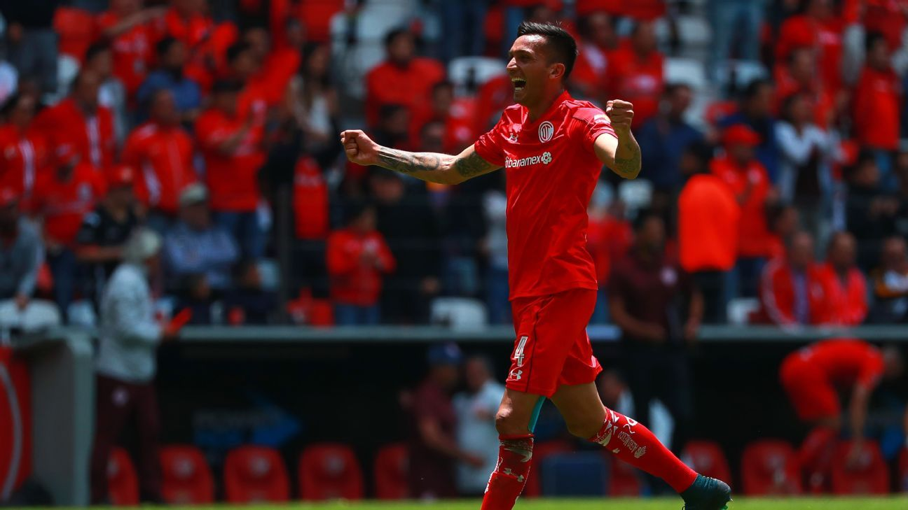 Maxi Perg celebrates after Toluca's 1-0 win over Tigres.
