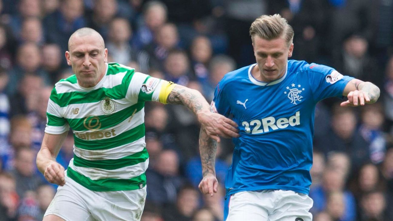 Rangers' Jason Cummings, right, and Celtic's Scott Brown.