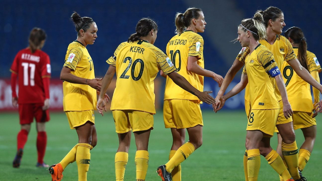 Players from Australia's women's team celebrate after scoring a goal in a 8-0 win against Vietnam.