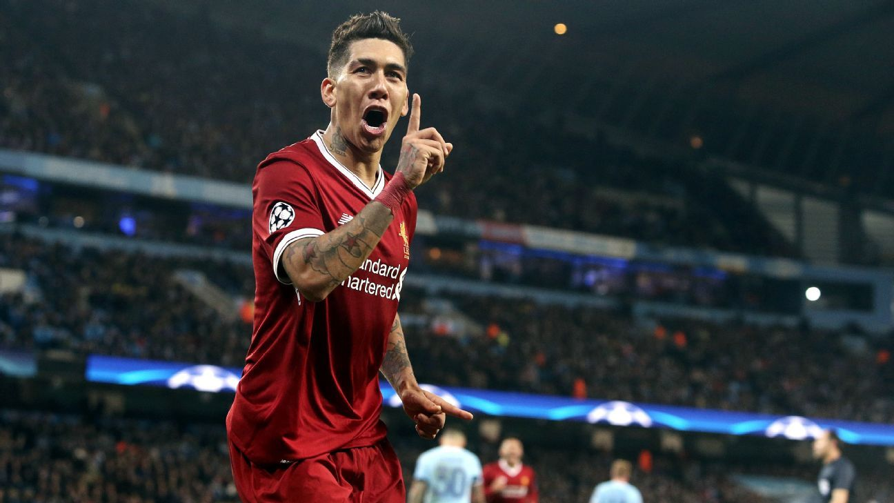 Roberto Firmino celebrates scoring in Liverpool's 2-1 win at Manchester City.
