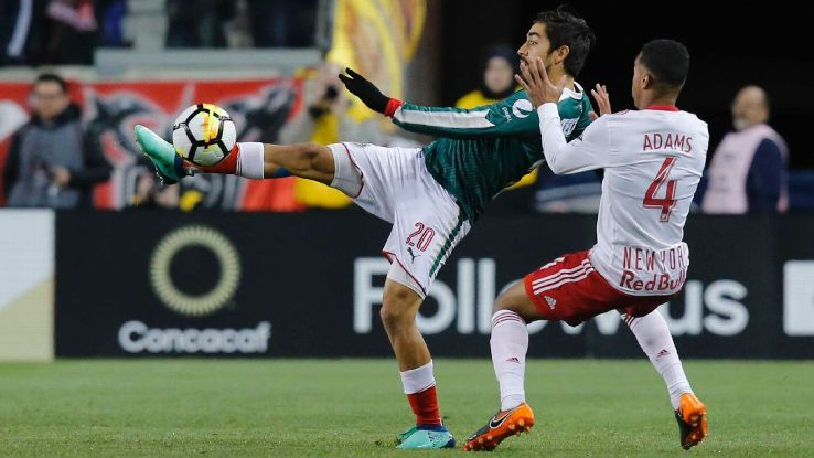 Chivas' Rodolfo Pizarro clears the ball away from New York Red Bulls' Tyler Adams in the CONCACAF Champions League.