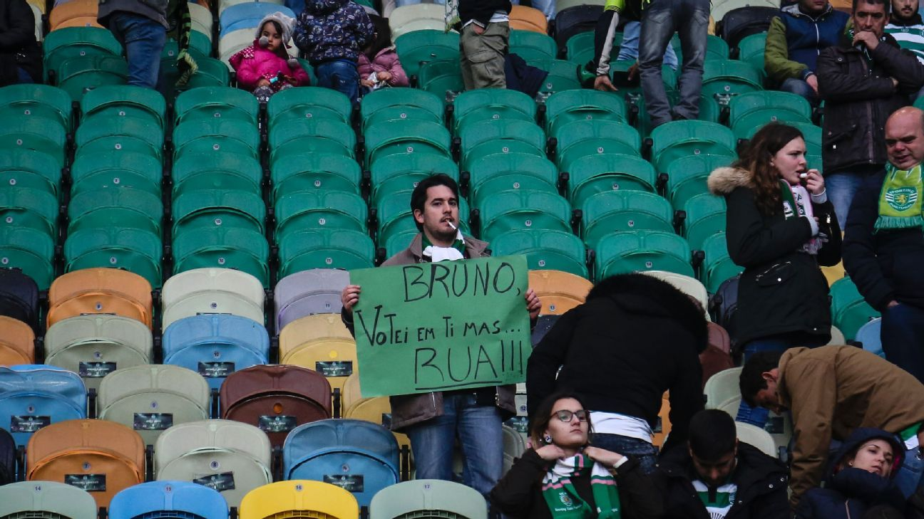 A Sporting supporter with a sign saying 'Bruno, I voted for you, but quit!'
