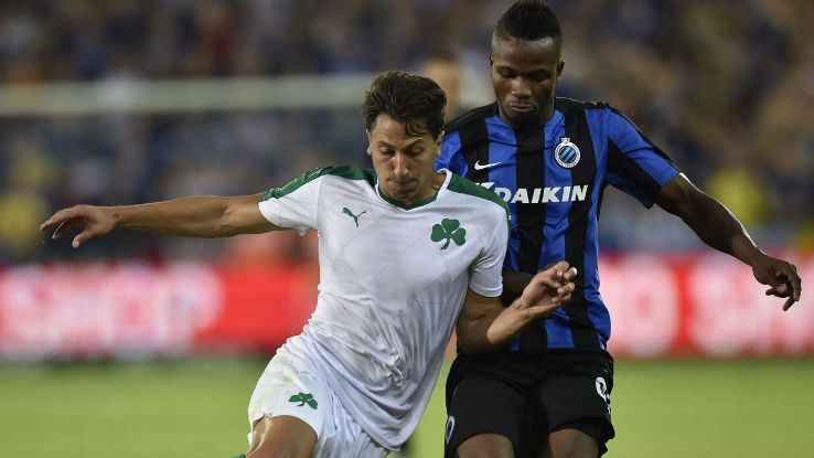 Panathinaikos' Jens Wemmer, left, vies for the ball with Bruges' Bolingoli Mbombo.
