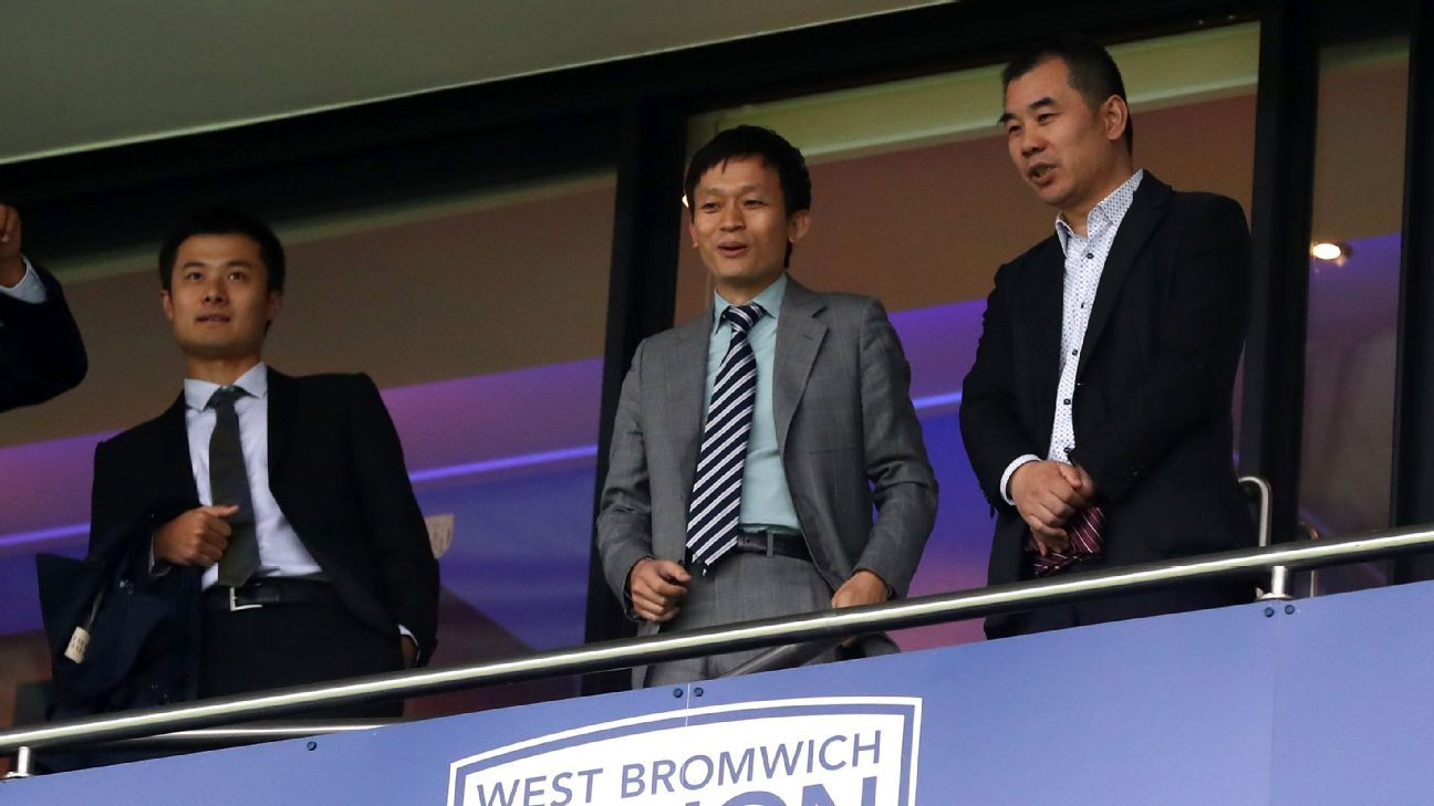 West Bromwich Albion owner Guochuan Lai, center.