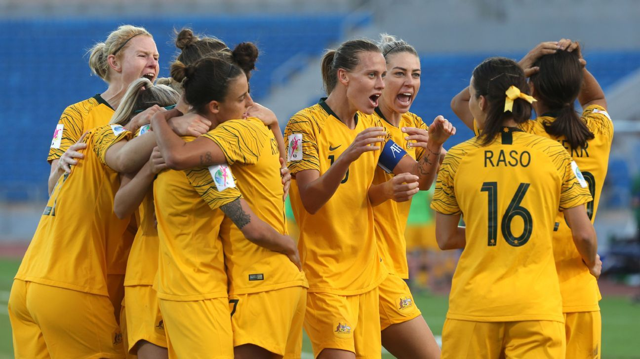 Australia players celebrate after a Samantha Kerr goal against Japan clinched their spot in the World Cup.