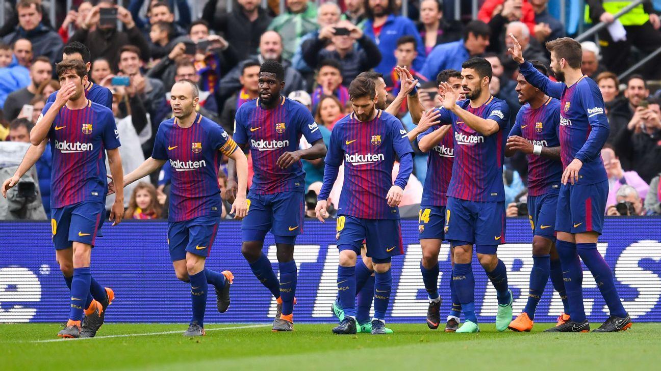 Barcelona celebrate Luis Suarez's opening goal against Valencia.