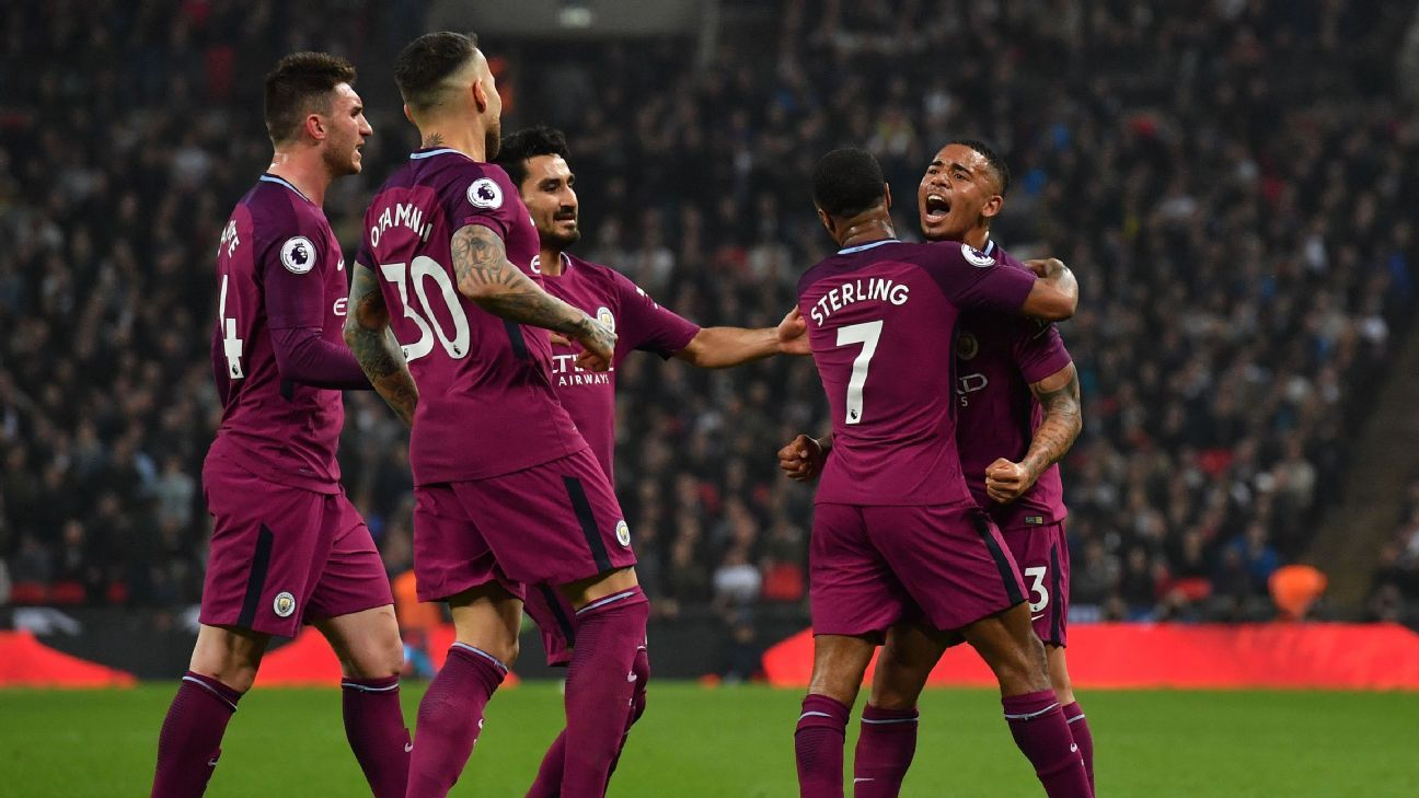 Man City celebrate their third goal against Tottenham.