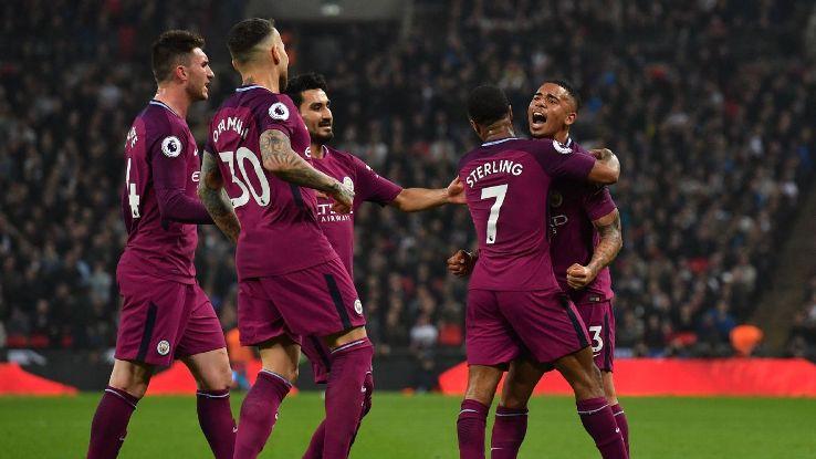 Man City celebrate their third goal against Tottenham.